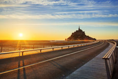 Road to Mont Saint Michel at sunset Stock Images
