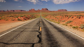 Road to Monument Valley. View of Monument Valley in Utah, looking south on U.S. Route 163 from 13 miles north of the Arizona/Utah State line Royalty Free Stock Image