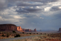 Road to Monument Valley. The setting sun and storm clouds above Monument Valley, Arizona, USA Royalty Free Stock Images