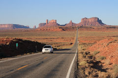 Road to Monument Valley with car. USA, Monument Valley- Road leading up to Valley with car Stock Photography