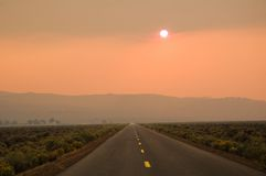 Road to Mordor. An eerie sunset as the sun appeared below the level of the smoke caused by forest fires in Northern California, which looked like the road to Royalty Free Stock Photos