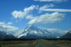 Road to Mount Cook, New Zealand. Road to Mount Cook around lake Pukaki, New Zealand Stock Photo