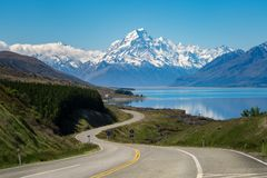 Road to Mount Cook, New Zealand. Road to Mount Cook, the highest mountain in New Zealand. A scenic highway drive along Lake Pukaki in Aoraki Mount Cook National stock photo