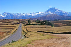 Road to the mountain. A nice landscape with a road in Bolivia, with cropfields and the Andes in the background Stock Images