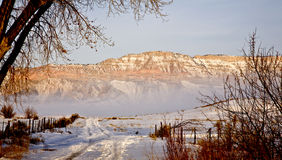 Road to Mountain in Winter. Road leading to a Mountain in Southern Utah's Castle Valley in the Winter Stock Images