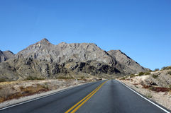 Road to the mountains. A road through the desert to the mountains Stock Image