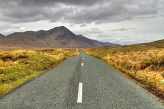Road to the mountains. Irish road with mountain view in Connemara Royalty Free Stock Images