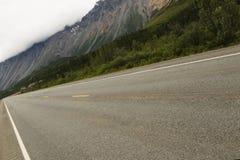 Road to mountains. Road towards Rainbow ridge, Alaska Range Royalty Free Stock Photos