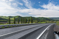 The road to the mountains background Royalty Free Stock Photos