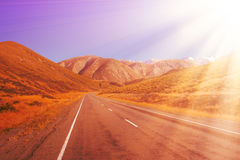 Road to the mountains with beautiful color. Stock Photos