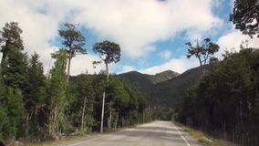 Road to mountains and coast line ocean in Argentina. stock footage