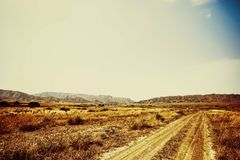 The road to the mountains. Journey through the savannah. Travel stock image