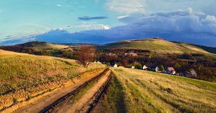 Road to the mountains. Russia. Village in province Royalty Free Stock Images