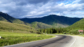Road to the mountains. It shows the road passes between the mountains Stock Images