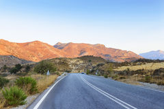 Road to the mountains on sunset Royalty Free Stock Photo