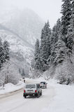 Road to mountains in the winter. Stock Photos