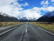 The Road to Mt Cook in New Zealand. Aoraki National Park offers impeccable views of Mount Cook in the Spring. The snow melt ensures lots of landscape contrast Royalty Free Stock Photos