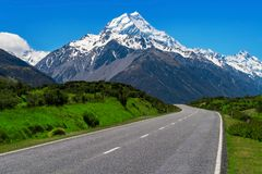 Road to Mt Cook, New Zealand. Road to Mt Cook and mountain landscape. Concept of road trip travel in New Zealand. Empty highway or freeway leading to Mount Cook royalty free stock image