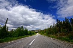 Road to nature. Lonely road very north in sweden leading in national park Stock Photos