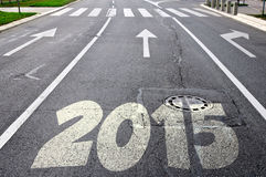 Road to new year 2015. With arrows in the background Royalty Free Stock Photo