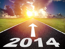 Road to the 2014 new year. And  sunrise background Royalty Free Stock Photo