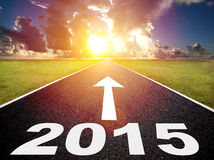 Road to the 2015 new year and sunrise background. Time concept Royalty Free Stock Photos