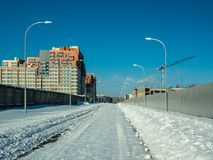 Winter road to a newly built residential complex Royalty Free Stock Photos