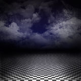 Road to nightmare - empty dark image. Empty, dark, psychedelic artistic image with black and white checker floor on the ground and ray of light in cloudy, dark Stock Photos