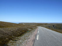 Road to Nordkapp, North Cape. Route to the northernmost point of Europe - Nordkapp (North Cape) in Norway. Nordkapp buildings are visible in the background of Stock Images