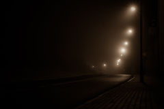 Road in the fog at night Royalty Free Stock Images