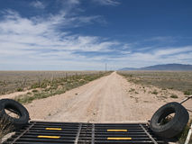 Road to Nowhere. Deserted desert road in New Mexico going nowhere but the horizon Stock Image