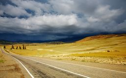 Road to nowhere. And storm clouds Stock Image