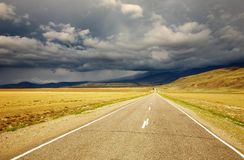 Road to nowhere. And storm clouds Royalty Free Stock Photos