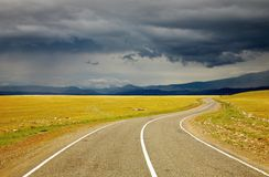 Road to nowhere. And storm clouds Stock Photography