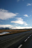 The road to nowhere. Empty road leading into the wilderness Royalty Free Stock Image