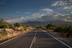 Road To Nowhere. Deserted road leading into the distance Stock Photo
