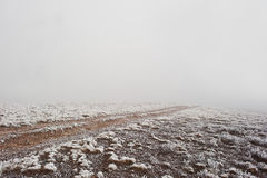 Road to nowhere. Frozen road on foggy mountain Stock Image