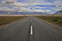 Road to nowhere. Lonely road leading to nowhere in beautiful New Zealand Stock Photo