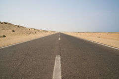 Road to nowhere. Lonely road leading nowhere in the desert Stock Photography