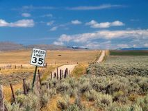 The road to nowhere, Montana. 35mph speed limit sign posted on a dirt road between fields on ranchlands leading to nowhere, Big Sky Country, Montana Stock Photo