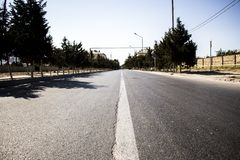 Road to nowhere. Paved road to nowhere traversed boring day in the hot summer Stock Image