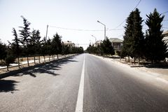 Road to nowhere. Paved road to nowhere traversed boring day in the hot summer Stock Photography