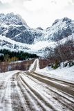 Road to Nusfjord in the winter. Scenic road to Nusfjord Lofoten, Norway in the winter royalty free stock photo