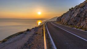 Road to orange sunset Stock Image