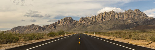 Road to the Organ Mountains. A rural road leads towards the towering Organ Mountains in Southern New Mexico Stock Photo