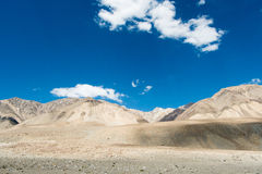 Road to Pangong Lake with light and shade on mountain. Royalty Free Stock Images