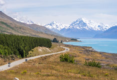 Road to Paradise in New Zealand. Winding road along Lake Pukaki heading towards Mt. Cook in New Zealand Royalty Free Stock Images