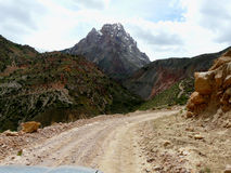 The road to the pass. The road in the fan mountains of Tajikistan Royalty Free Stock Images