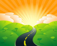 Road to prosperity. A country road moving toward a sunrise Royalty Free Stock Images