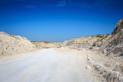 Road to quarry. Limestone mining. White rocks Royalty Free Stock Photo